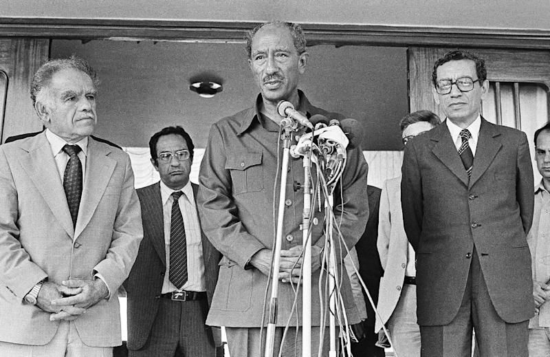"FILE - In this Sept. 10, 1980 file photo, Egyptian President Anwar Sadat, center, flanked by Israeli Foreign Minister, Yitzhak Shamir, left, and Egyptian Minister of State for Foreign Affairs, Butros Ghali tells reporters, in Alexandria, Egypt, that ""It has been a happy occasion to meet with Minister Shamir, we had a very friendly and fruitful discussion."" Former Israeli Prime Minister Yitzhak Shamir, who clung throughout his life to the belief that Israel should hang on to territory and never trust an Arab regime, has died. He was 96 years old. Israeli media said he died at a nursing home in Herzliya Saturday, June 30, 2012, while Israeli Prime Minister Benjamin Netanyahu issued a statement mourning Shamir's death.(AP Photo/Foley, File)"
