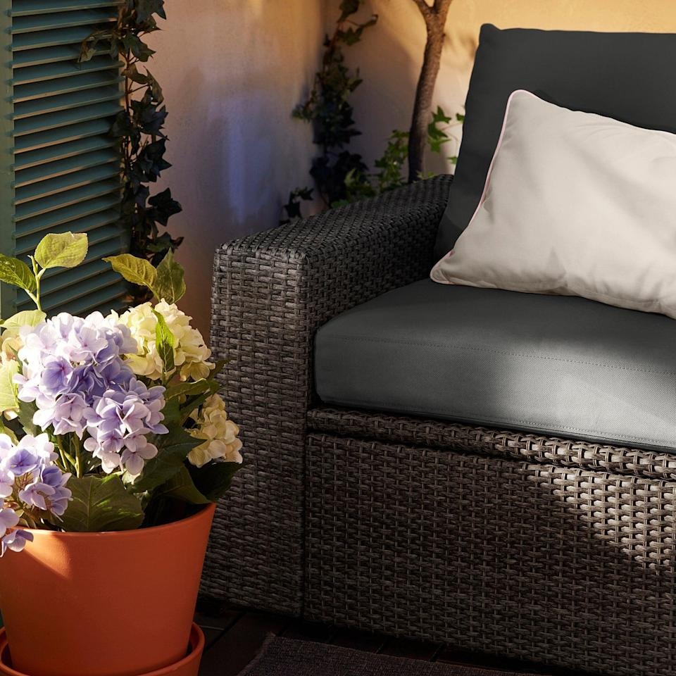 """<p>Complement your outdoors with this <a href=""""https://www.popsugar.com/buy/Soller%C3%B6n-Armchair-454599?p_name=Soller%C3%B6n%20Armchair&retailer=ikea.com&pid=454599&price=280&evar1=casa%3Aus&evar9=46226851&evar98=https%3A%2F%2Fwww.popsugar.com%2Fhome%2Fphoto-gallery%2F46226851%2Fimage%2F46226927%2FSoller%C3%B6n-Armchair&list1=shopping%2Cfurniture%2Cikea%2Csummer%2Csmall%20space%20living%2Coutdoor%20decorating%2Chome%20shopping&prop13=api&pdata=1"""" class=""""link rapid-noclick-resp"""" rel=""""nofollow noopener"""" target=""""_blank"""" data-ylk=""""slk:Sollerön Armchair"""">Sollerön Armchair</a> ($280), and tuck away extra items in its handy storage compartment.</p>"""