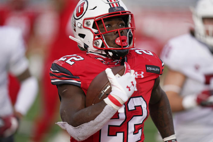 FILE - In this Dec. 19, 2020, file photo, Utah running back Ty Jordan (22) scores against Washington State during the second half of an NCAA college football game, in Salt Lake City. Authorities say Jordan died at a hospital in the Dallas area after accidently shooting himself. University officials announced Ty Jordan's death Saturday, the day after he was named Pac-12's newcomer of the year. (AP Photo/Rick Bowmer, File)