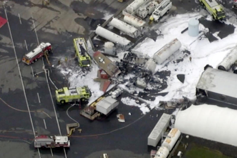 In this aerial image taken from video, emergency crews respond to where a World War II-era bomber B-17 plane crashed at Bradley International Airport in Windsor Locks, Conn., Wednesday, Oct. 2, 2019.  (WFXT Boston 25 News via AP)