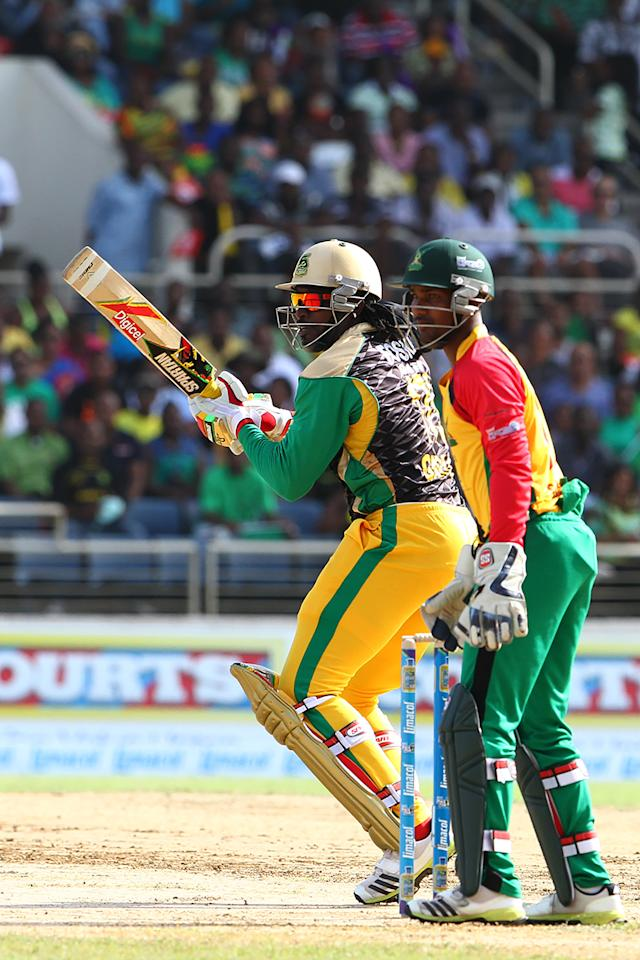 KINGSTON, JAMAICA - AUGUST 15: Chris Gayle and Denesh Ramdin during the Sixteenth Match of the Cricket Caribbean Premier League between Jamaica Tallawahs v Guyana Amazon Warriors at Sabina Park on August 15, 2013 in Kingston, Jamaica. (Photo by Ashley Allen/Getty Images Latin America for CPL)