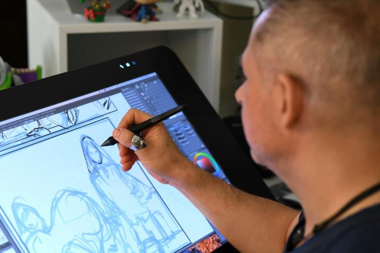 French comic book illustrator Phil Briones works in his home office in Los Angeles (AFP Photo/Robyn Beck)