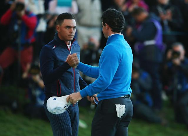 AUCHTERARDER, SCOTLAND - SEPTEMBER 26: Rickie Fowler of the United States shakes hands with Rory McIlroy of Europe as they halve their match during the Afternoon Foursomes of the 2014 Ryder Cup on the PGA Centenary course at the Gleneagles Hotel on September 26, 2014 in Auchterarder, Scotland. (Photo by Andrew Redington/Getty Images)