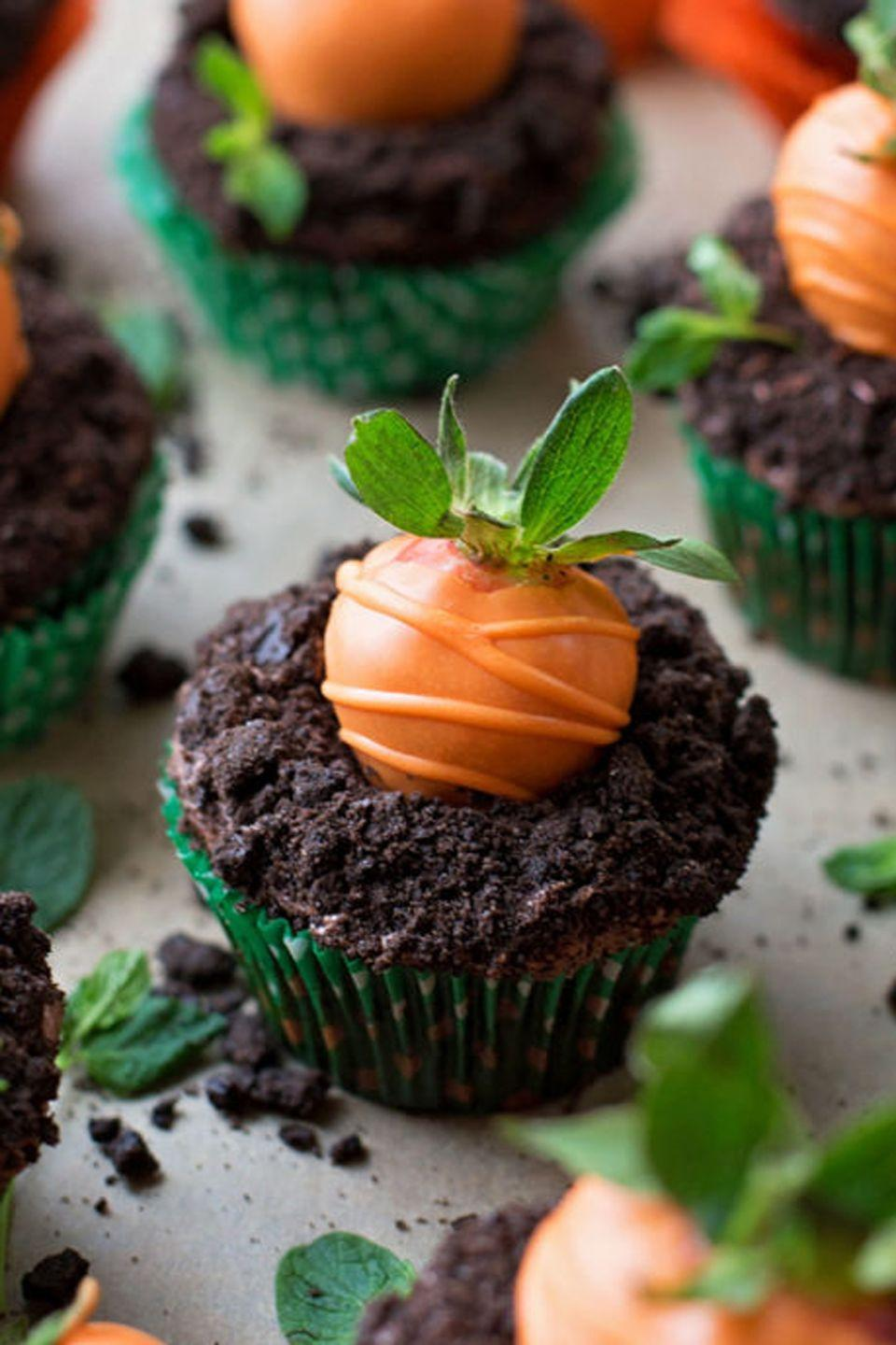 """<p>Rumor has it that the Easter bunny <em>might </em>make a pit stop at your house if you have these chocolate-strawberry treats out on the table. </p><p><a href=""""https://lifemadesimplebakes.com/2016/03/carrot-patch-cupcakes/"""" rel=""""nofollow noopener"""" target=""""_blank"""" data-ylk=""""slk:Get the recipe from Life Made Simple »"""" class=""""link rapid-noclick-resp""""><em>Get the recipe from Life Made Simple »</em></a></p>"""