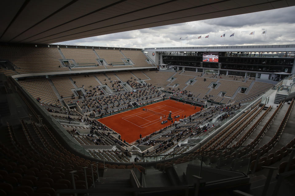 FILE - This is a view of the center court where Poland's Iga Swiatek waits for Sofia Kenin of the U.S. to return from medical treatment during the women's singles final match of the French Open tennis tournament at Roland Garros stadium in Paris, France, in this Saturday, Oct. 10, 2020, file photo. The AP has put together a quiz for you to test your knowledge before the clay-court major championship begins Sunday. (AP Photo/Alessandra Tarantino, File)