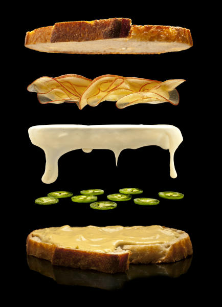 This undated illustration provided by Modernist Cuisine on July 16, 2013 shows aged white cheddar cheese on sourdough bread with apples, and sliced jalapenos. (AP Photo/Modernist Cuisine, Chris Hoover)