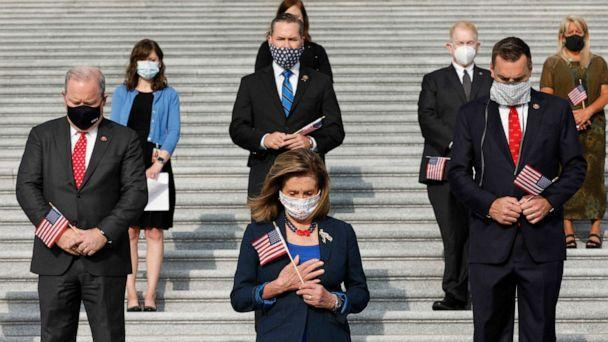 PHOTO: House Speaker Nancy Pelosi and members of Congress hold moment of silence observing National Day of Service and Remembrance on the East Front Steps on Capitol Hill in Washington on Sept. 11, 2020. (Gripas Yuri/ABACAPRESS.COM via Newscom)