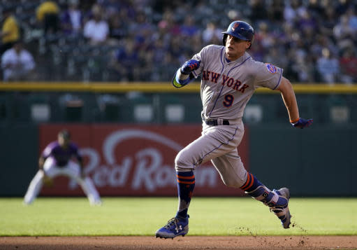 New York Mets' Brandon Nimmo rounds the bases to score an in the park home run against the Colorado Rockies during the first inning of a baseball game, Monday, June 18, 2018, in Denver. (AP Photo/Jack Dempsey)