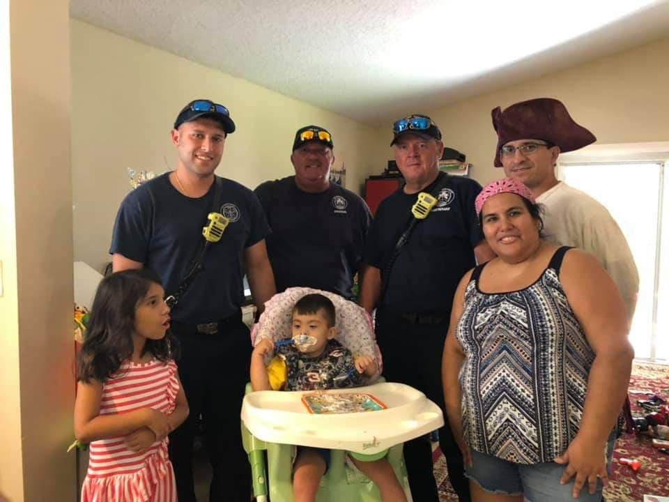 A few firefighters joined in on the birthday party for Shemy. (Photo courtesy of Susan Casado)