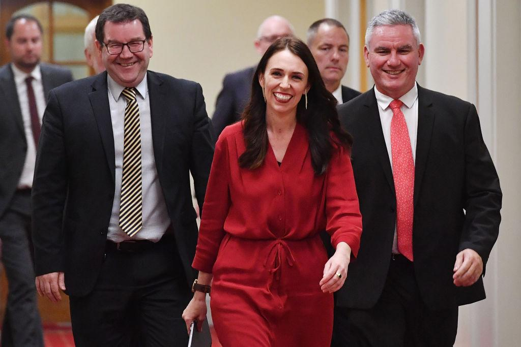 <p>Jacinda Ardern, center, after her party's October victory. She is the third woman to lead her country. (Photo: Getty Images) </p>