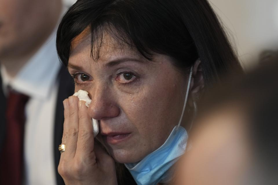 FILE - In this May 27, 2021, file photo, Natalia Pratasevich, the mother of Belarus dissident journalist Raman Pratasevich, cries during a news conference in Warsaw, Poland, where she made an emotional appeal for her son's freedom. The journalist was arrested on Sunday, May 23, 2021, after Belarusian flight controllers told the crew of a Ryanair jetliner he was on to land in Minsk, citing a bomb threat. (AP Photo/Czarek Sokolowski, File)