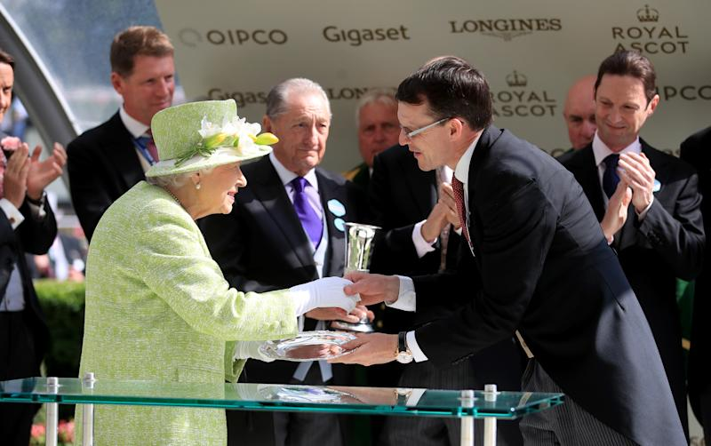Queen Elizabeth II with winning conections after Blue Point wins the Diamond Jubilee Stakes during day five of Royal Ascot at Ascot Racecourse. (Photo by Adam Davy/PA Images via Getty Images)