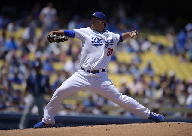 Los Angeles Dodgers starting pitcher Hyun-Jin Ryu, of South Korea, throws to the plate during the first inning of a baseball game against the San Diego Padres, Sunday, July 13, 2014, in Los Angeles. (AP Photo/Mark J. Terrill)