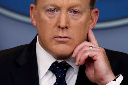 FILE PHOTO: White House Press Secretary Spicer listens to a reporter's question during his daily briefing at the White House in Washington