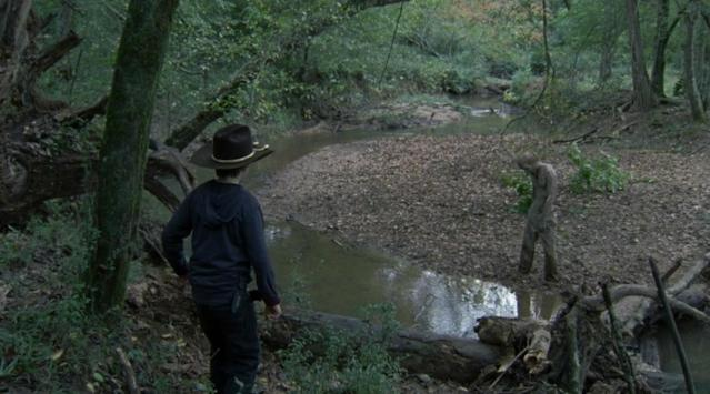 <p>In a bored and bratty mood, Carl swiped Daryl's gun and went off into the woods, where he found a walker stuck in mud. He threw rocks at it and got closer so he could shoot it, but when it got partially free and moved closer to him, he panicked, dropped the gun, and ran back to Hershel's farm. Not only did he leave the walker alive (well, undead), but he also didn't tell anyone about it … leaving it free to sneak up on Dale and kill him later in the episode.<br><br>(Photo: AMC) </p>