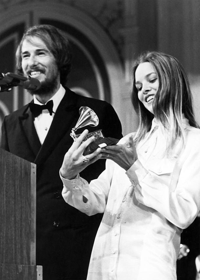 "<p>John Phillips and Michelle Phillips of the rock group The Mamas & The Papas receive a Grammy award for Best Contemporary Group Performance for their song ""Monday, Monday."" </p>"