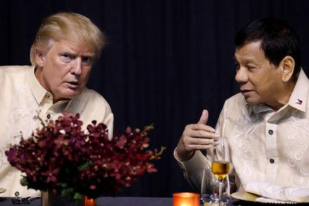 President Trump attends the Association of Southeast Asian Nations (ASEAN) Summit gala dinner in Manila, Philippines.     REUTERS/Jonathan Ernst