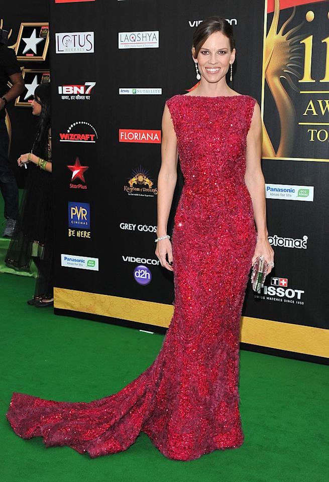 """Oscar winner Hilary Swank turned heads as soon as she stepped out of her limo -- at the International Indian Film Academy Awards -- thanks to her sensational Elie Saab Spring 2011 Couture gown, classic updo, and statement earrings. Va-va-voom! George Pimentel/<a href=""""http://www.wireimage.com"""" target=""""new"""">WireImage.com</a> - June 25, 2011"""