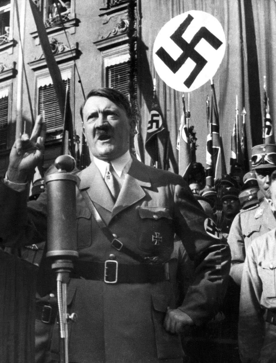 """FILE - An undated file picture shows the leader of the National Socialists Adolf Hitler, gesturing during a speech. A prominent European Jewish organization is criticizing a Munich auction house's decision to sell several of Nazi dictator Adolf Hitler's handwritten speeches, saying it """"defies logic, decency and humanity"""" to put them on the market(dpa via AP, file)"""
