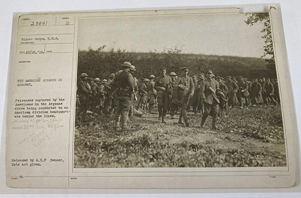 This photo provided by the U.S. Army Heritage and Education Center that shows American soldiers with German prisoners in northern France during WWI on Sept. 26, 1918 is shown attached to a sheet with historical information of the image. The claim in Pennsylvania state Sen. Doug Mastriano's 2014 book about Sgt. York, that this U.S. Army Signal Corps photo was mislabeled and actually shows Alvin C. York with three German officers he captured, has been disputed by rival researchers. (U.S. Army's signal corps via AP)
