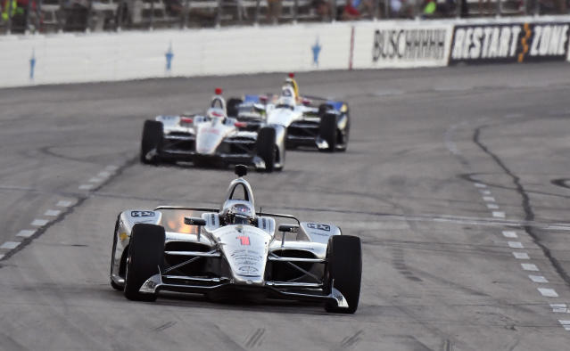 Josef Newgarden heads into Turn 1 during the IndyCar auto race Saturday, June 9, 2018, in Fort Worth, Texas. (AP Photo/Larry Papke)