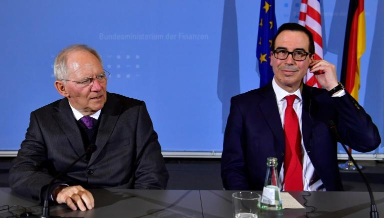 German Finance Minister Wolfgang Schaeuble (L) and US Secretary of the Treasury Steven Mnuchin attend a press conference at the finance ministry in Berlin