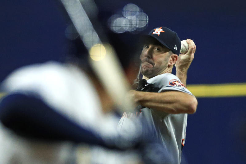 Houston Astros' Justin Verlander pitches against the Tampa Bay Rays in the first inning of Game 4 of a baseball American League Division Series, Tuesday, Oct. 8, 2019, in St. Petersburg, Fla. (AP Photo/Mike Erhmann, Pool)