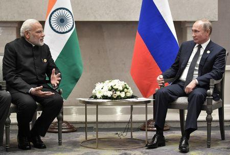 Russian President Putin and Indian Prime Minister Modi attend a meeting on the sidelines of the BRICS summit in Johannesburg