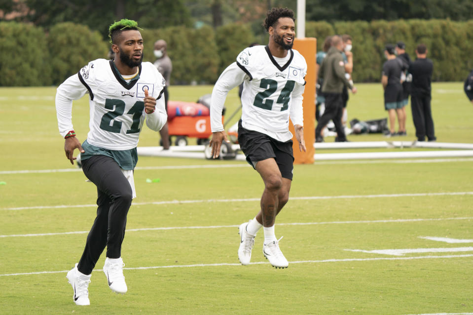 Philadelphia Eagles safety Jalen Mills, left, warms up with cornerback Darius Slay, right, during an NFL football practice, Thursday, Sept. 24, 2020, in Philadelphia. (AP Photo/Chris Szagola, Pool)