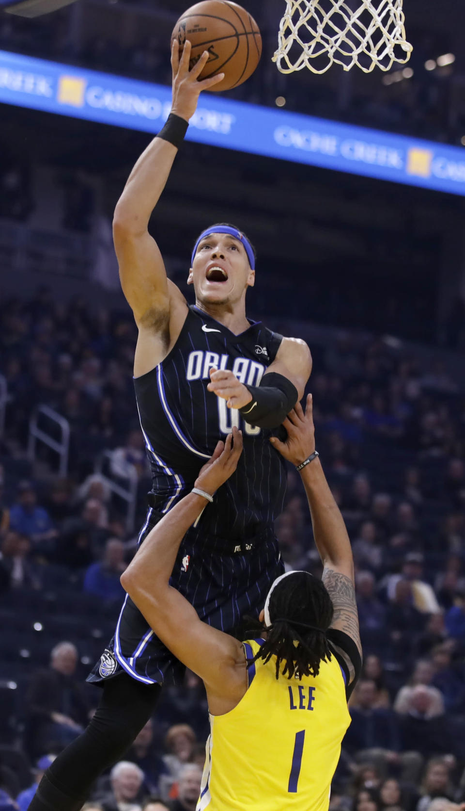 Orlando Magic's Aaron Gordon shoots over Golden State Warriors' Damion Lee (1) in the first half of an NBA basketball game Saturday, Jan. 18, 2020, in San Francisco. (AP Photo/Ben Margot)
