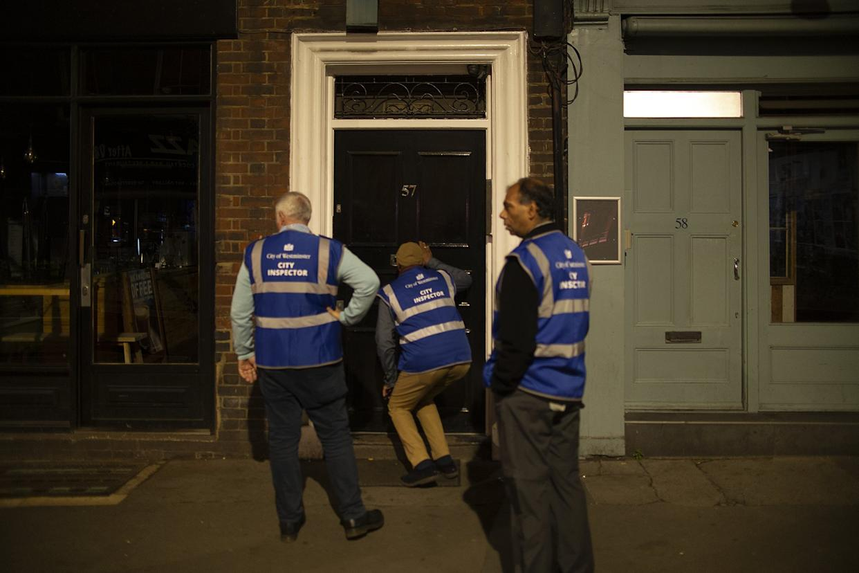 COVID inspectors peer through pub doors tlooking for lock-ins as the country begins its 10pm curfew for bars and restaurants - measures which could last up to six months (Dan Barker/Twitter)