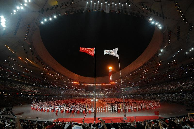 The Olympic flame is lit during the opening ceremony of the 2008 Beijing Olympic Games, at the National Stadium in the Chinese capital (AFP Photo/NICOLAS ASFOURI)