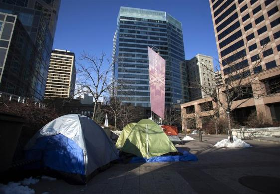 A small Occupy Wall Street camp sits in a public plaza across the street from Goldman Sachs' office building at 222 South Main Street in Salt Lake City, Utah January 11, 2012.