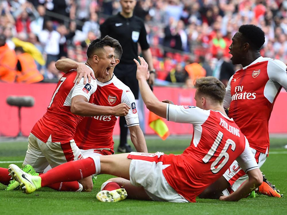 Alexis Sanchez scores the winning goal in extra-time to send Arsenal through to the FA Cup final: Getty