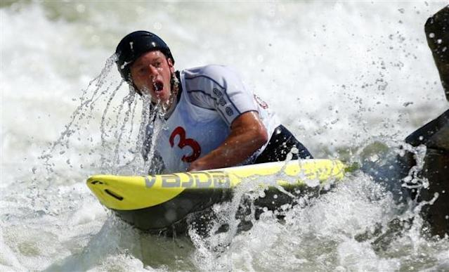 Tyler Hinton takes a breath after going under the water while competing in the men's C1 during the U.S. Olympic trials for whitewater slalom in Charlotte, North Carolina April 13, 2012.