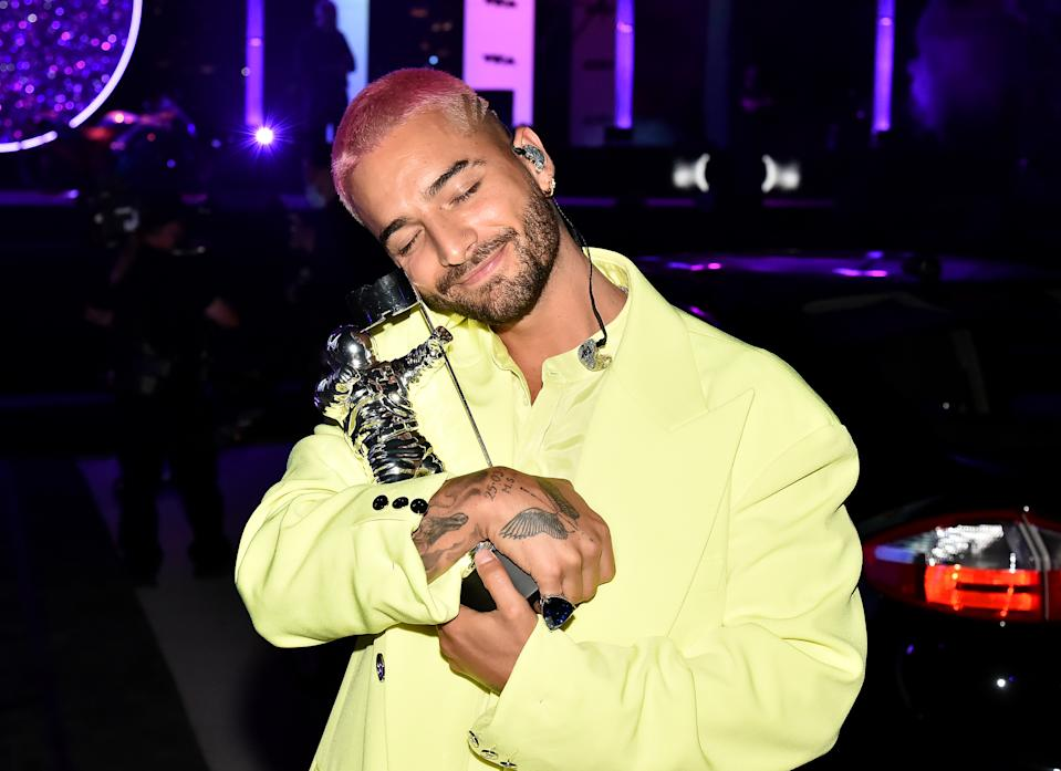 "NEW YORK, NEW YORK - AUGUST 30: Maluma accepts the Best Latin award for ""Qué Pena"" with J Balvin, during the 2020 MTV Video Music Awards broadcast at the Skyline Drive-In on Sunday, August 30, 2020 in New York City. (Photo by Jeff Kravitz/MTV VMAs 2020/Getty Images for MTV)"