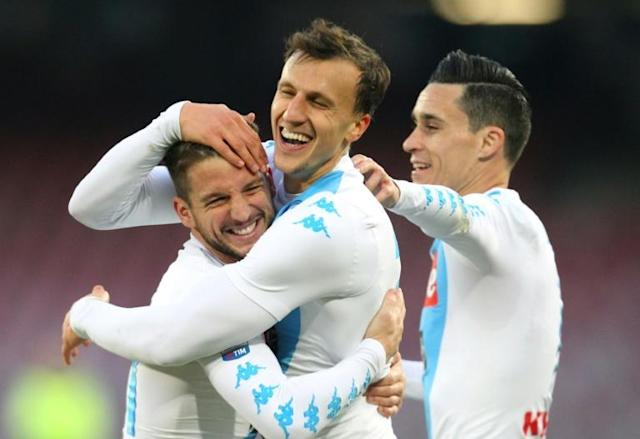 Napoli's defender from Romania Vlad Chiriches (C) celebrates after scoring with Dries Mertens (L) and Jose Maria Callejon on December 18, 2016