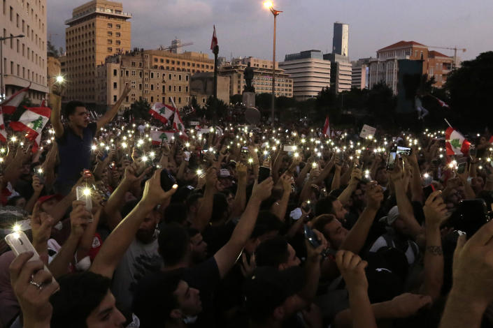 Protesters fresh their smartphone's lights during a protest against the Lebanese government in Beirut, Lebanon, Saturday, Oct. 19, 2019. The blaze of protests was unleashed a day earlier when the government announced a slate of new proposed taxes, including a $6 monthly fee for using Whatsapp voice calls. The measures set a spark to long-smoldering anger against top leaders from the president and prime minister to the numerous factional figures many blame for decades of corruption and mismanagement. (AP Photo/Hassan Ammar)