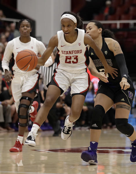 Stanford's Kiana Williams (23) drives the ball past Washington's Mai-Loni Henson, right, in the second half of an NCAA college basketball game Sunday, Jan. 5, 2020, in Stanford, Calif. (AP Photo/Ben Margot)