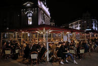 FILE - In this Friday, Oct. 16, 2020 file photo, people eat out in Lille, northern France. France on Friday Oct. 23, 2020 surpassed 1 million confirmed coronavirus cases, becoming the second country in Western Europe after Spain to reach the mark. (AP Photo/Michel Spingler, File)