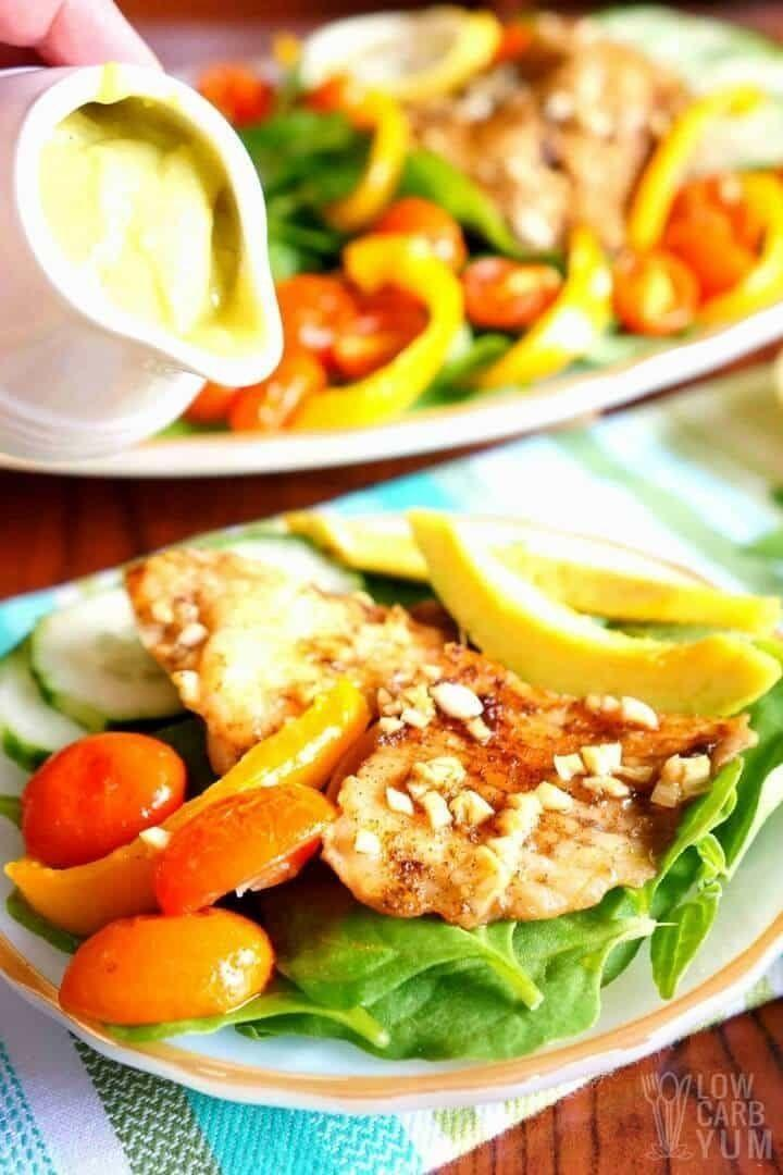 """<strong>Get the <a href=""""https://lowcarbyum.com/tilapia-salad-creamy-avocado-dressing/"""" target=""""_blank"""" rel=""""noopener noreferrer"""">Tilapia Salad With Spinach and Creamy Avocado Dressing</a> recipe from Low Carb Yum.</strong>"""