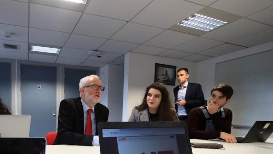Jeremy Corbyn explains Labour's broadband policy to students at Lancaster University (Reuters)