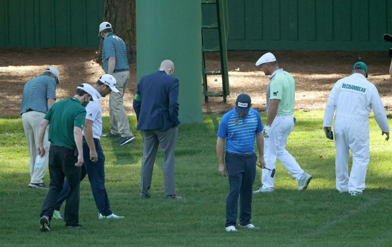 Lost ball: Bryson DeChambeau looks for his ball along with playing partners Jon Rahm and Louis Oosthuizen in the second round of the Masters at Augusta National