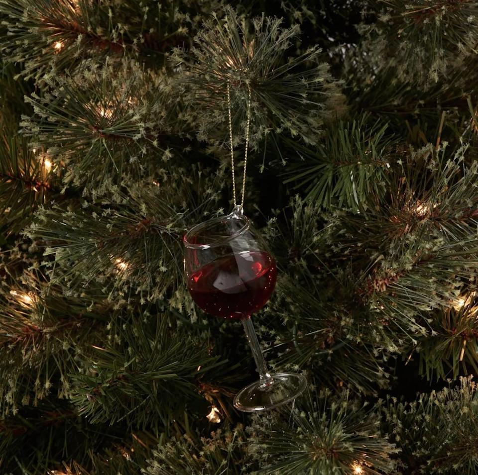 <p>Hang this <span>Wine Glass Christmas Tree Ornament</span> ($6) for a boozy holiday. </p>