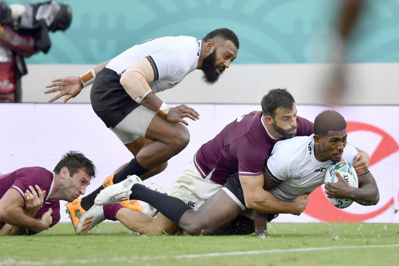 Fiji's Frank Lomani scores a try during the Rugby World Cup Pool D game at Hanazono Rugby Stadium between Georgia and Fiji in Osaka, western Japan, Thursday, Oct. 3, 2019. (Ren Onuma/Kyodo News via AP)