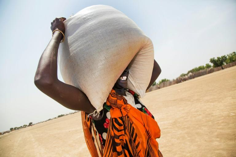 A woman carries a sack of food distributed in Ganyiel, Panyijiar county, in South Sudan
