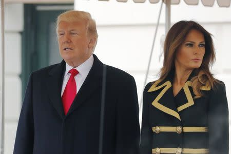 U.S. President Donald Trump and first lady Melania Trump wait to welcome Australian Prime Minister Malcolm Turnbull and Lucy Turnbull to the White House in Washington, U.S., February 23, 2018. REUTERS/Jonathan Ernst