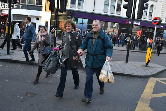 People heading away from the vicinity of Borough Market in London after police told them to leave the area.