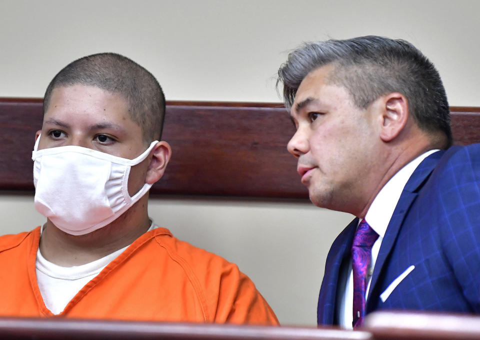 FILE - In this July 30, 2021 file photo Joseph Jimenez, 20, left, appears with his attorney Charles Kenyon in the Riverside Hall of Justice, in Riverside, Calif. Jimenez, a man suspected of shooting two people, killing one, inside a Southern California movie theater has been charged with murder and attempted murder, prosecutors said. The young man who had been on life support after he and a friend were shot has died, police and his family said Saturday, July 31, 2021. (Will Lester/The Orange County Register via AP,File)