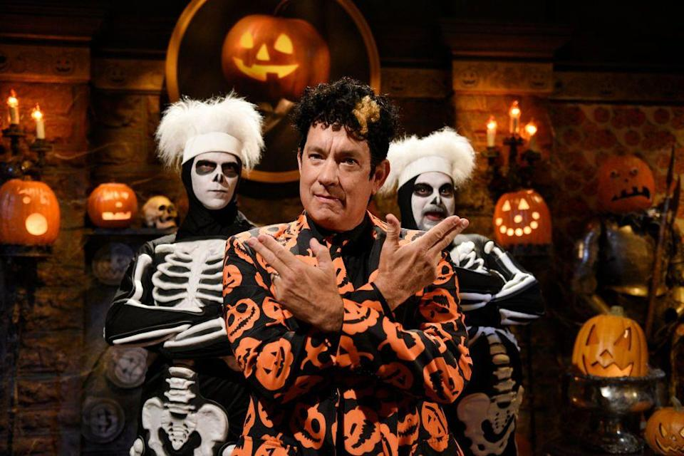 """<p>Tom Hanks took the <em>Saturday Night Live</em> stage dressed as David S. Pumpkins, complete with jack-o'-lantern suit. After his first appearance in 2016, he became famous for his catchphrase, """"Any questions?""""</p>"""